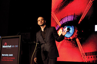 The late Barnaby Jack presents at Black Hat 2010.