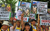South Koreans activists denouncing the North's cyberattacks during a rally in Seoul on July 10. Phot