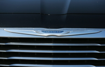 Fiat Chrysler, Harman hit with class action suit over